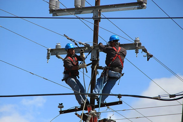 Two line workers working